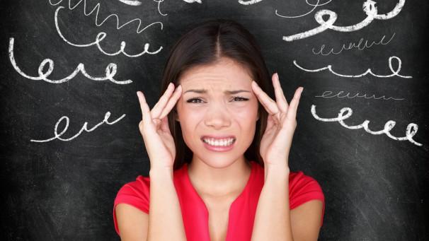 Stress - woman stressed with headache