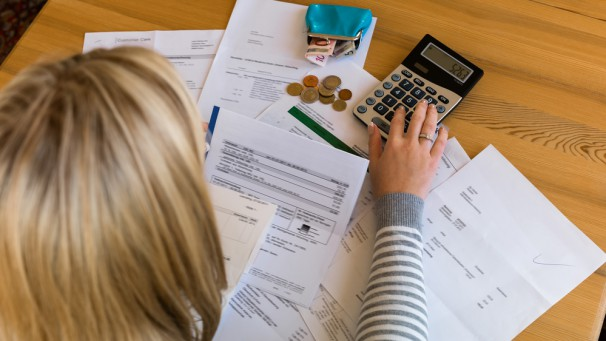 woman with unpaid bills and debts
