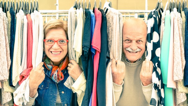Playful senior couple at weakly flea market - Concept of active